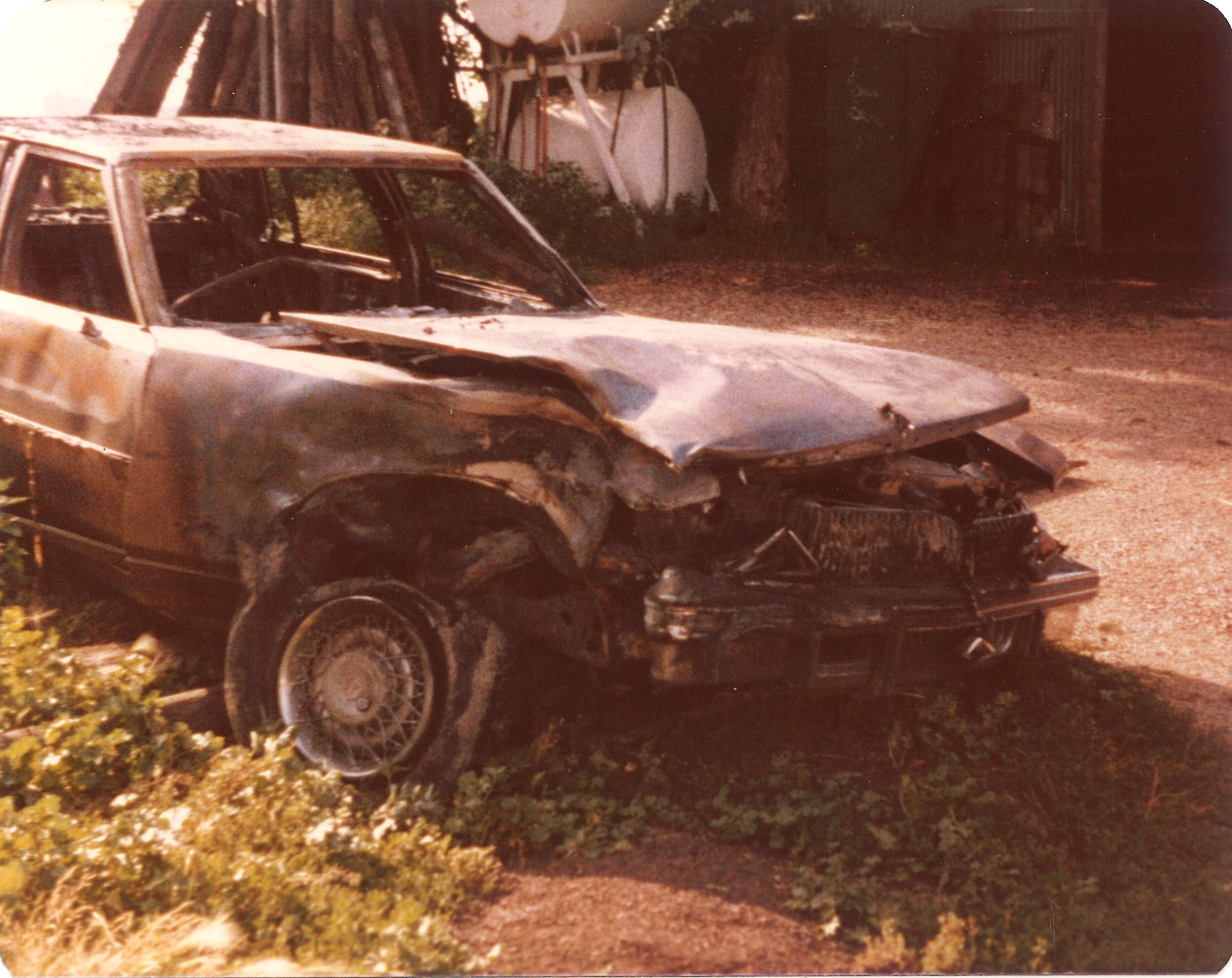 Burned Cadillac Seville front right July1979